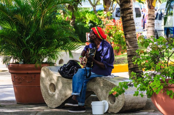 EDITORIAL-ONLY-Ovidiu-Curic.Local-man-was-playing-guitar-songs-of-Jimy-Hendrix-near-the-cruise-ship-peer-shutterstock_1094594954