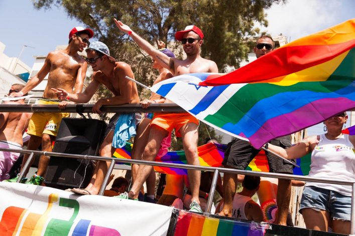 EDITORIAL-ONLY-elbud-People-partying-at-the-annual-gay-parade-in-the-streets-of-Tel-Aviv-Israel-on-June-7-2013.-shutterstock_142613047