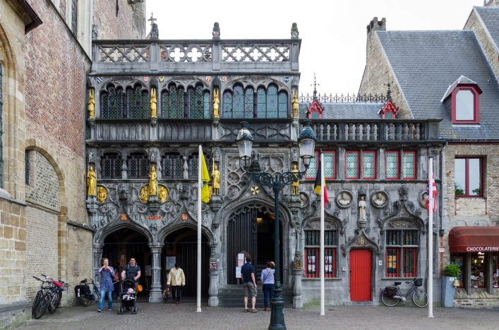 EDITORIAL-ONLY-siraanamwong-Tourist-visit-Basilica-of-the-Holy-Blood-in-Bruges-Belgium-on-May-11-2015.-Basilica-is-located-in-the-Burg-square-.-iStock-502785076