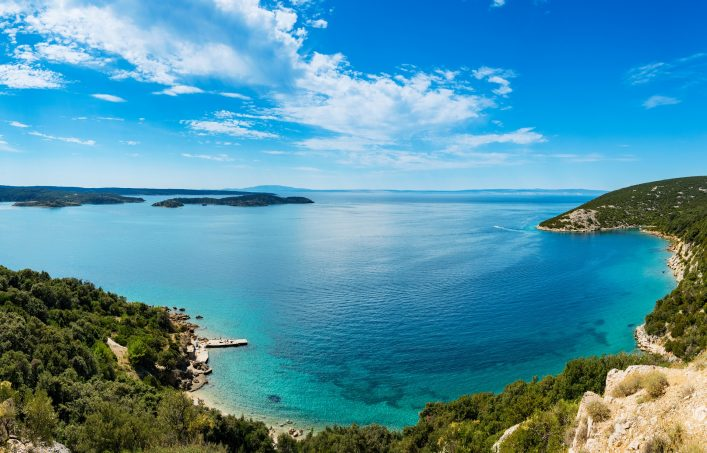 Panoramic-view-of-Adriatic-Sea-and-island-Cres-in-the-distance-near-town-Lopar-on-island-Rab-in-Croatia-shutterstock_1027618081