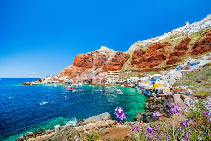 The-old-harbor-of-Ammoudi-under-the-famous-village-of-Ia-at-Santorini-Greece-shutterstock_630008048
