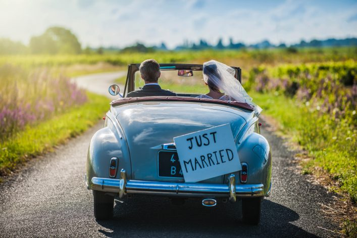 couple-is-driving-a-convertible-retro-car-on-a-country-road-for-their-honeymoon-shutterstock_261887489-2