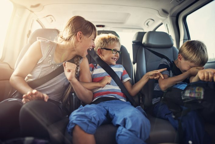 Happy kids travelling by car