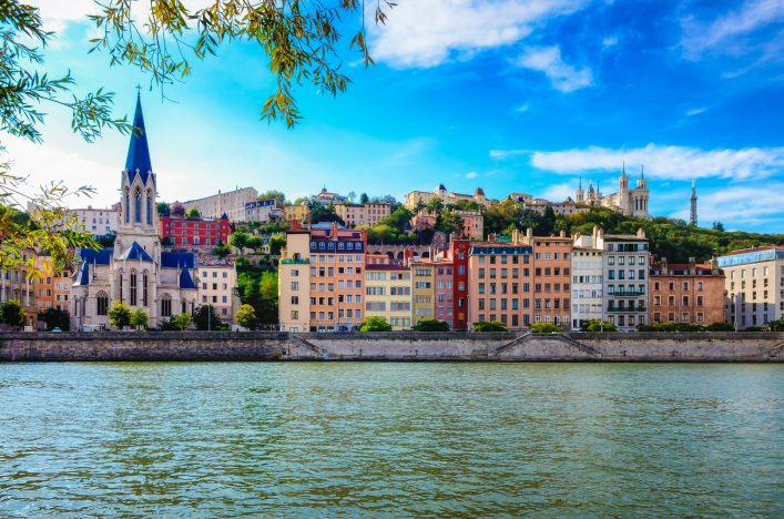 lyon-cityscape-from-saone-river-with-colorful-houses-and-river-shutterstock_114141832-2