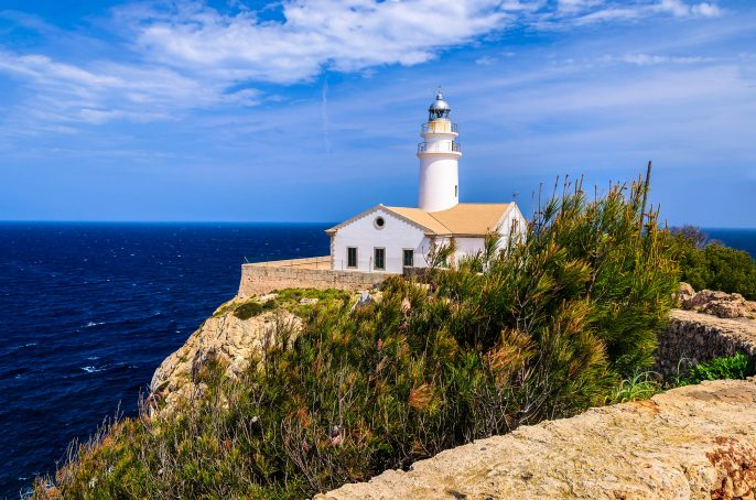White-building-lighthouse-cliff-sea-view-Cala-Ratjada-Majorca-island-Spain-shutterstock_143327527-2