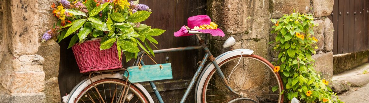 shutterstock_old-bike_street_flowers_150617546-e1462171278841