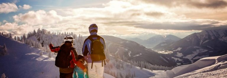 Happy-family-in-winter-clothing-at-the-ski-resort-iStock_73558605_900x600