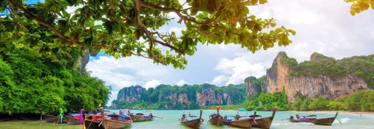 boat-on-Railay-beach-in-Krabi-Thailand.-Asia_516728413